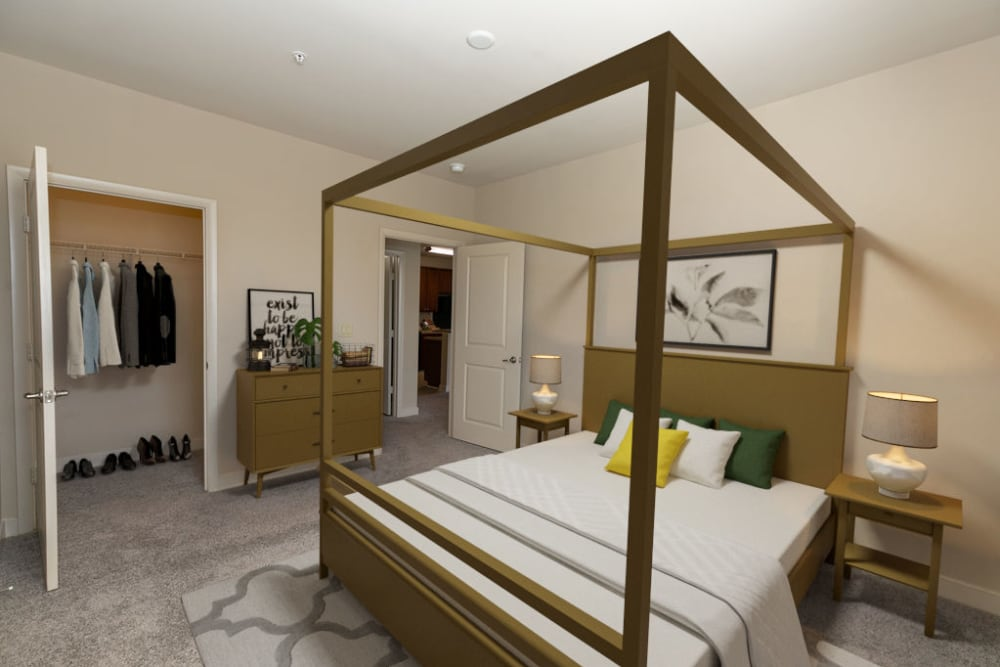 Model bedroom with canopy bed at McBee Station in Greenville, South Carolina
