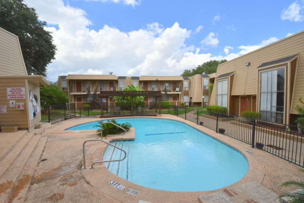 Resort-style swimming pool at Falls of Maplewood Apartments in Houston, Texas