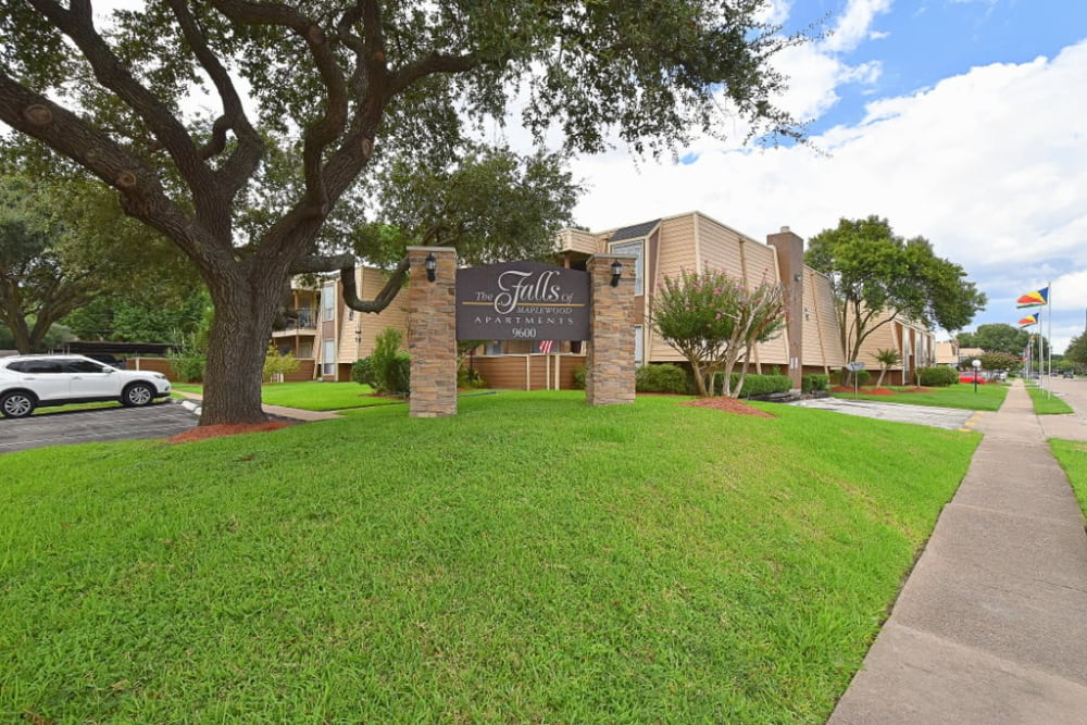 Lush landscaping at Falls of Maplewood Apartments in Houston, Texas