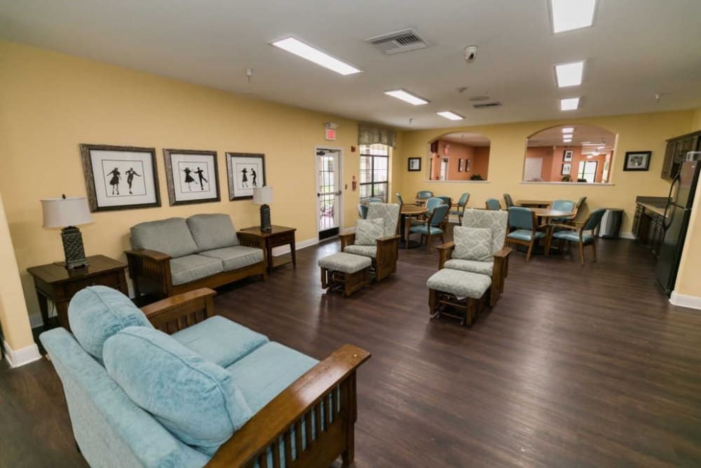 Elegant seating area with blue chairs at RockBrook Memory Care in Lewisville, Texas
