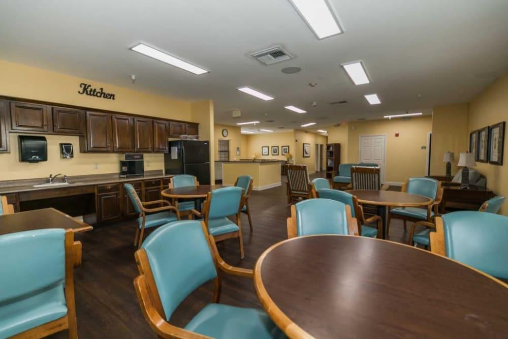 Elegant dining seating at RockBrook Memory Care in Lewisville, Texas