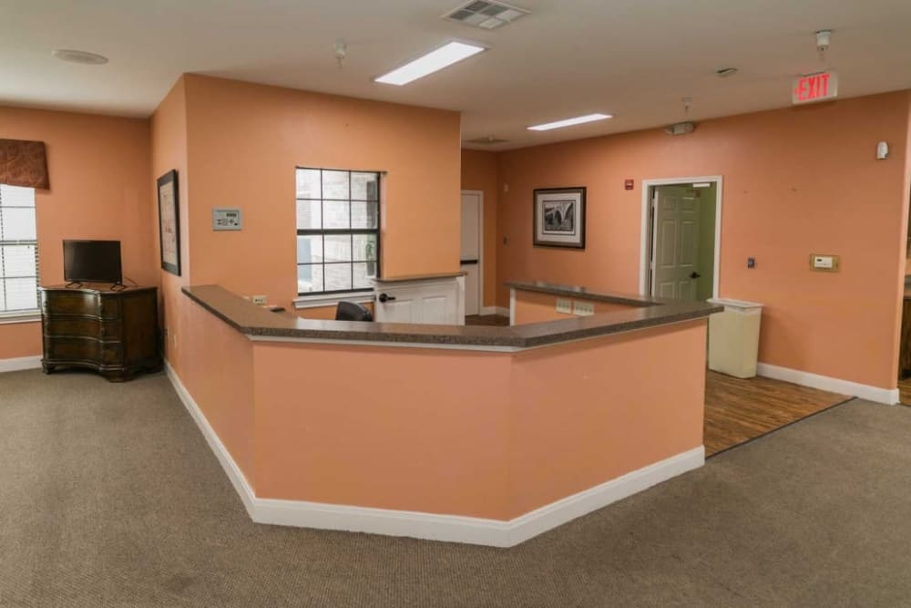 Cheerful peach front desk at RockBrook Memory Care in Lewisville, Texas