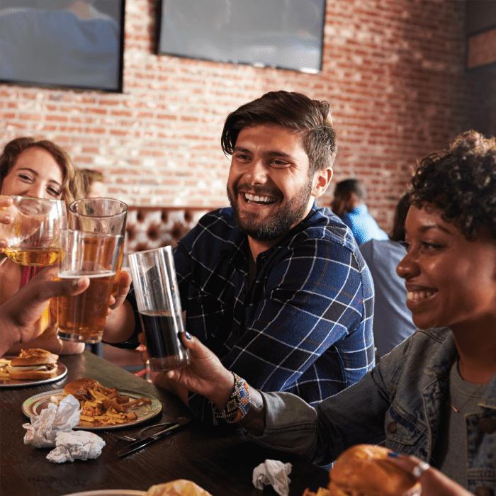 Friends enjoying drinks in Tulsa, Oklahoma near Creekwood Apartments