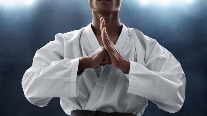 Man preparing for a karate demonstration in a blog article on our website at Olympus Northpoint in Albuquerque, New Mexico