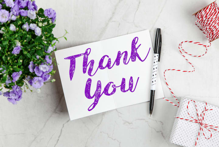Thank you card with presents and flowers