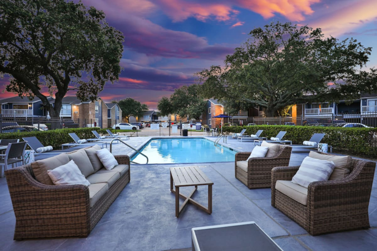 Swimming pool with lounge chairs at Barringer Square in Webster, Texas