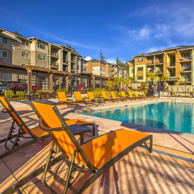 Sundeck with comfortable lounge chairs at Vue Issaquah in Issaquah, Washington