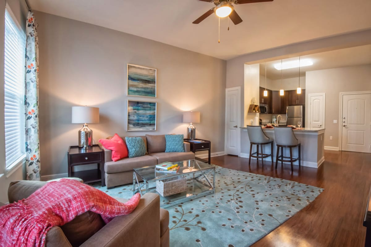 Spacious living room and kitchen at Artistry at Craig Ranch in McKinney, Texas