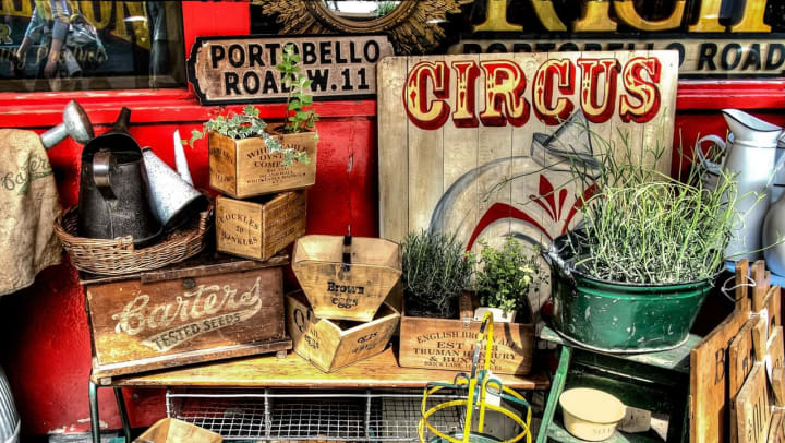 Assorted vintage items on a table at the Beach Boulevard Flea Market near Wimberly at Deerwood in Jacksonville, Florida