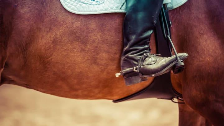 Resident enjoying horseback riding lessons near Olympus Woodbridge in Sachse, Texas.