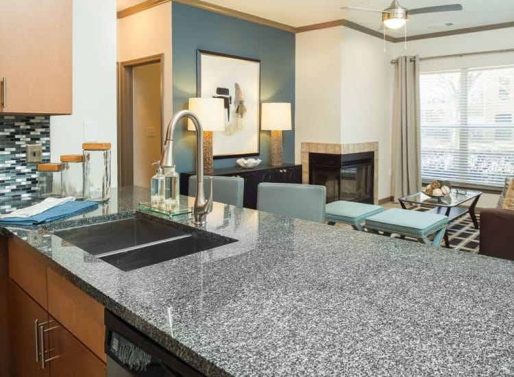 View of living area from model home's kitchen in open-concept floor plan at Presley Oaks in Charlotte, North Carolina