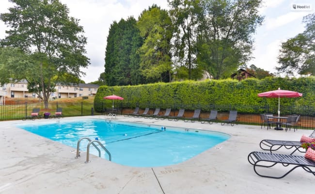 Beautiful swimming pool with lounge chairs at Huntersville Apartment Homes in Huntersville, North Carolina