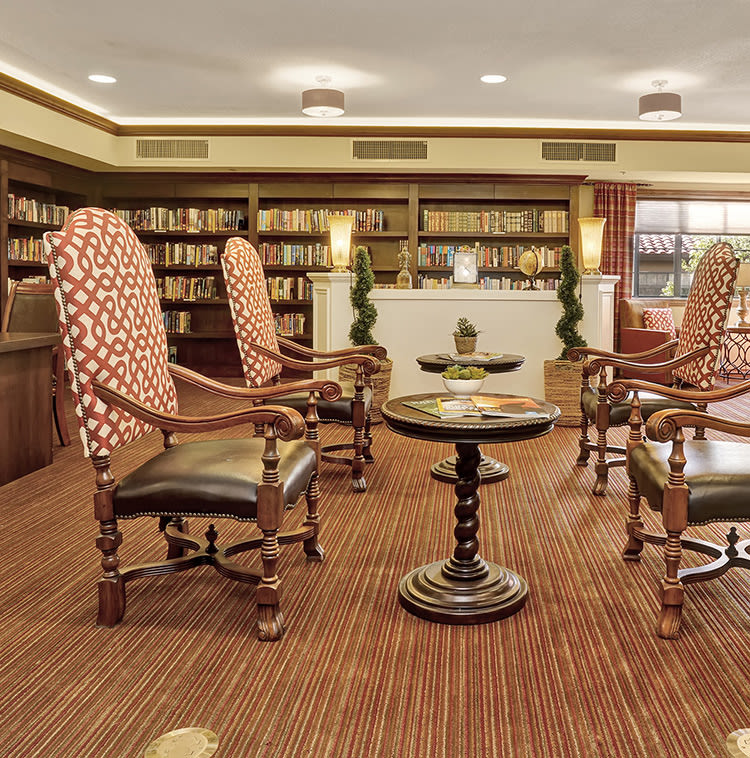 Reading area in the library at The Country Club of La Cholla