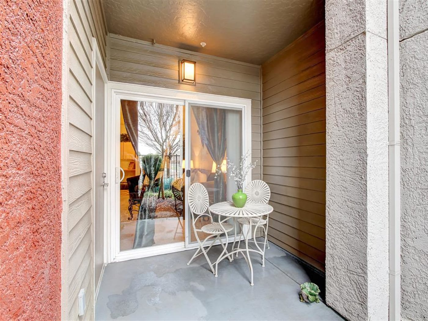 Covered private patio outside a model home at Eaglewood Apartments in Woodland, California