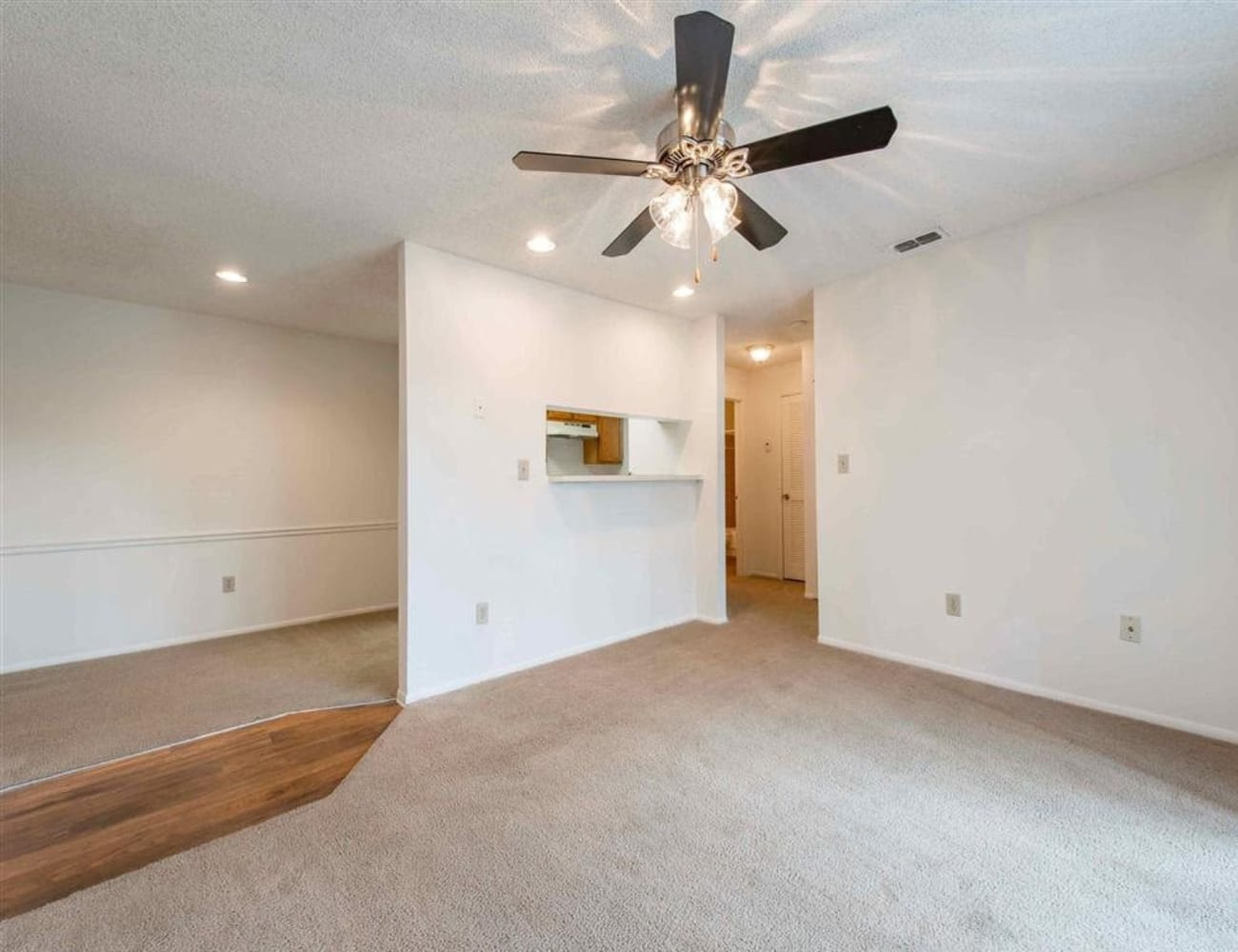 Open-concept layout with plush carpeting at Compass in Melbourne, Florida