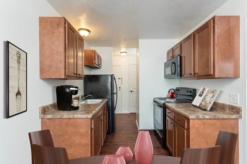 Fully-equipped kitchen with island at Wedgewood West in Rochester