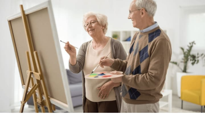 Senior couple painting together