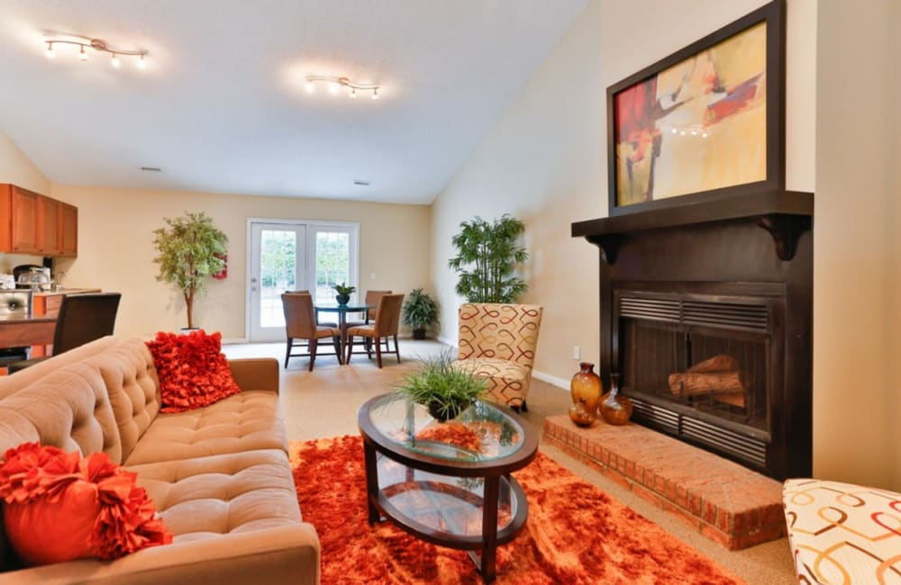 Luxury clubhouse with a fireplace at Huntersville Apartment Homes in Huntersville, North Carolina