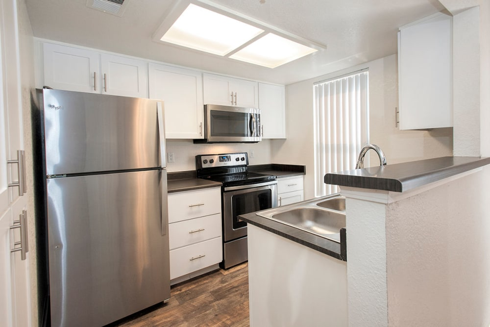Spacious kitchen with stainless-steel appliances at Sandpiper Village Apartment Homes in Vacaville, California