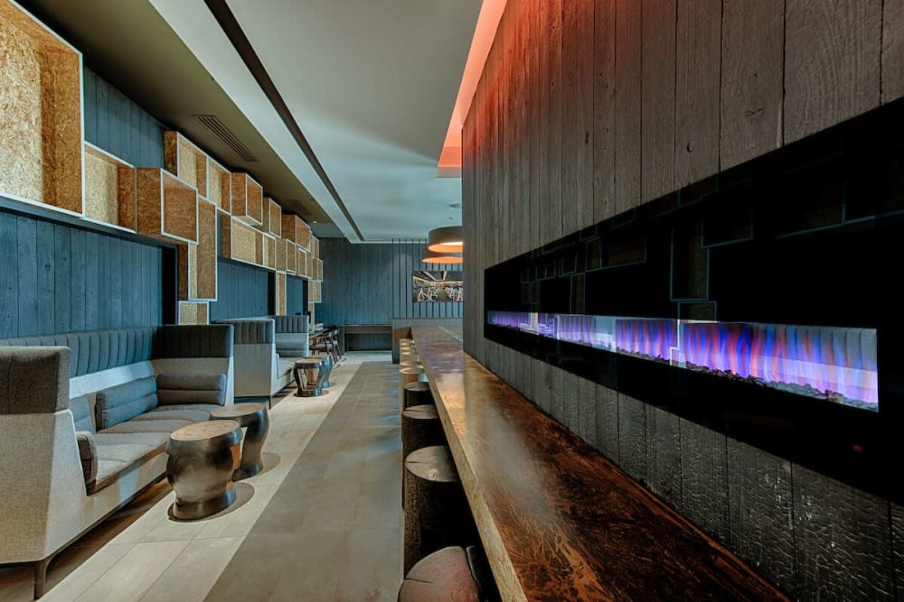 Clubhouse with cool purple fireplace at The TOMSCOT in Scottsdale, Arizona