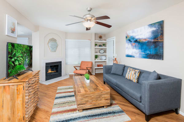 Spacious living room layout with autumn-toned furniture at San Marin at the Civic Center