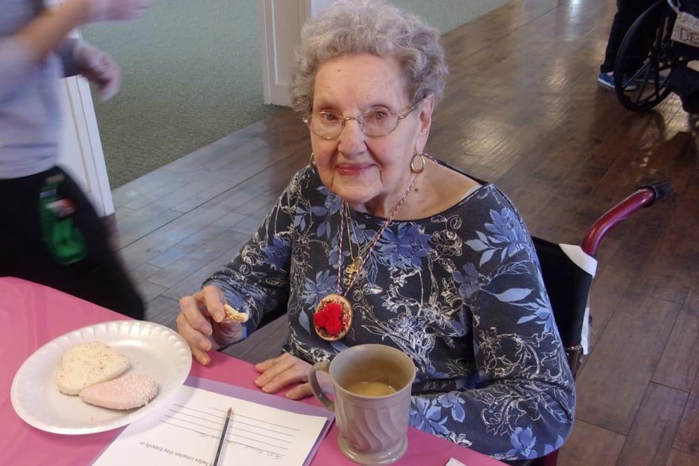 senior woman enjoying some cookies