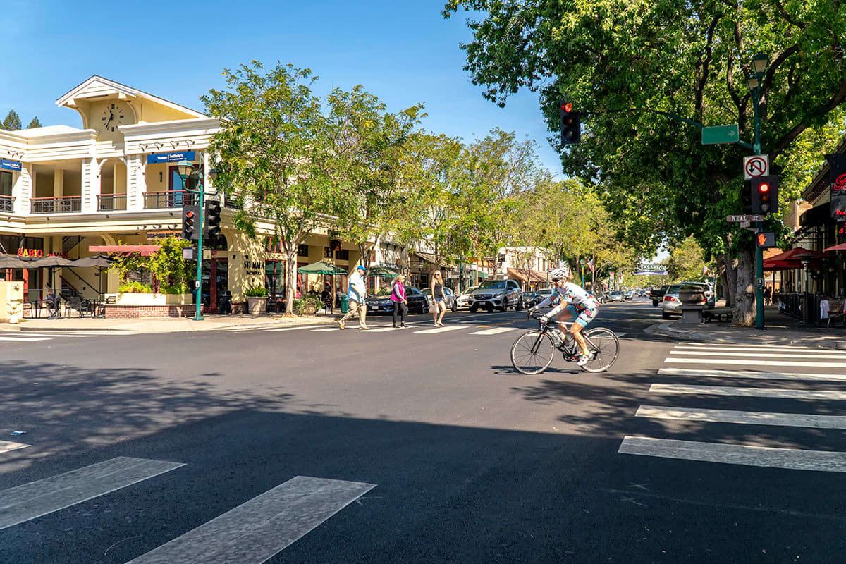 Resident biking downtown on a beautiful day near Valley Plaza Villages in Pleasanton, California
