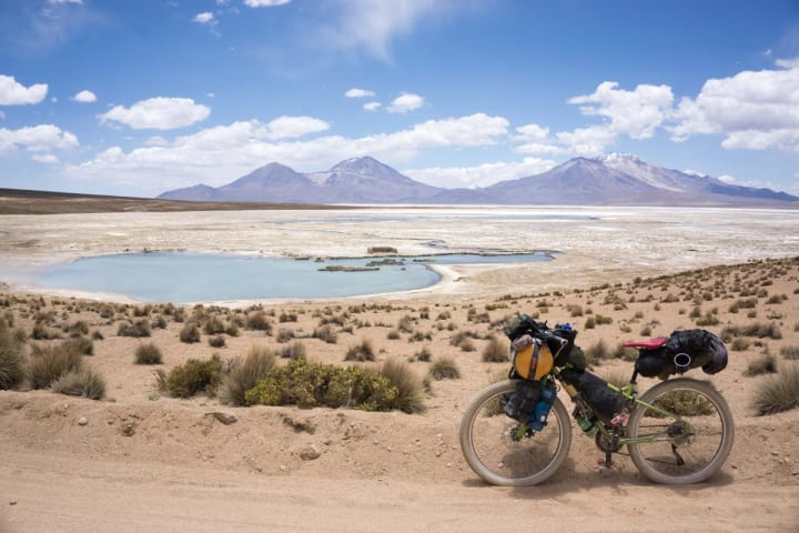 A bike on a dirt trail with a beautiful view