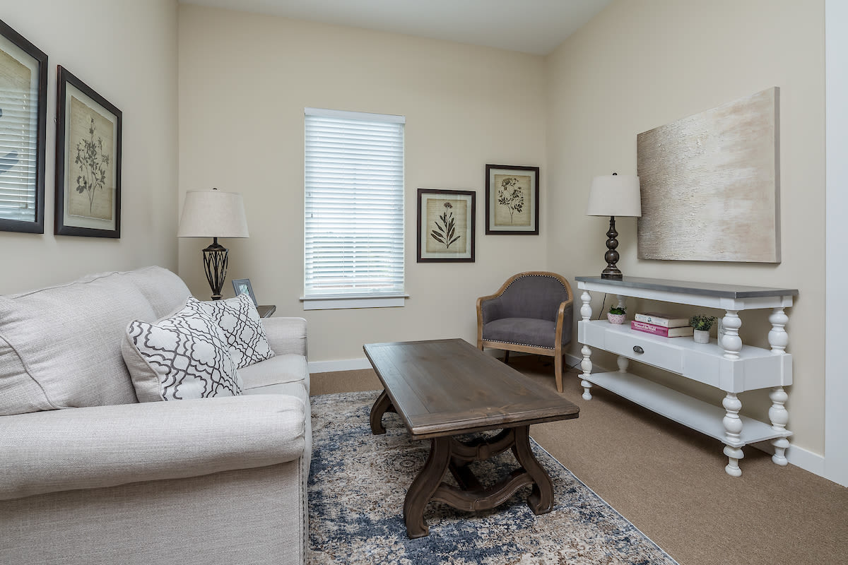 A spacious resident living room at The Claiborne at Gulfport Highlands in Gulfport, Mississippi.