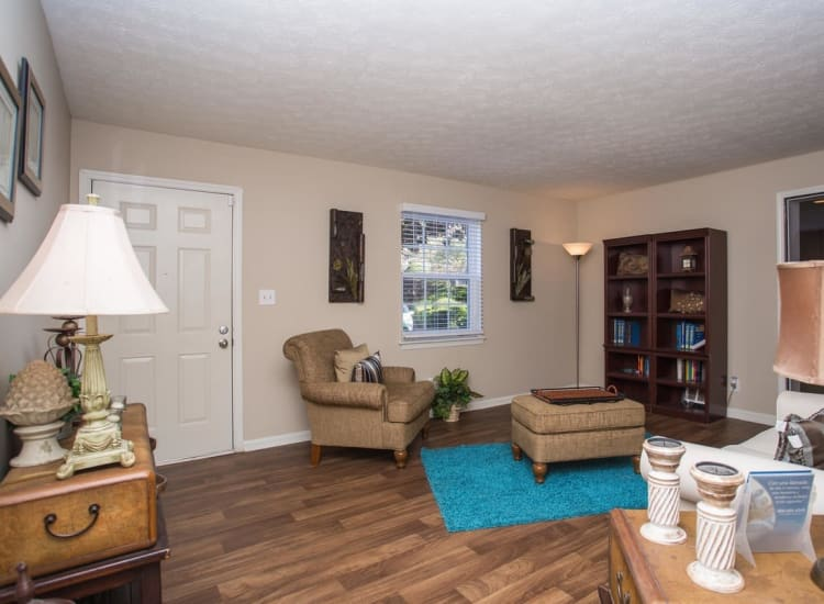 Comfortable living area with hardwood flooring in a model home at The Arbors at Smyrna in Smyrna, Georgia