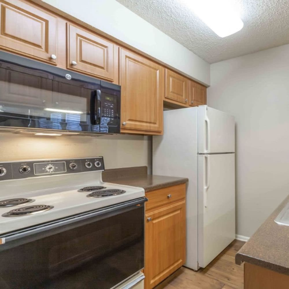 Kitchen with a microwave and stove at Royal Palms in San Antonio, Texas