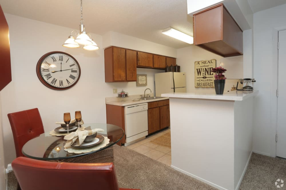 Open dining room and kitchen with pass through opening at Double Tree Apartments in El Paso, Texas