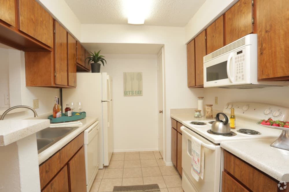 Well-lit kitchen at Double Tree Apartments in El Paso, Texas