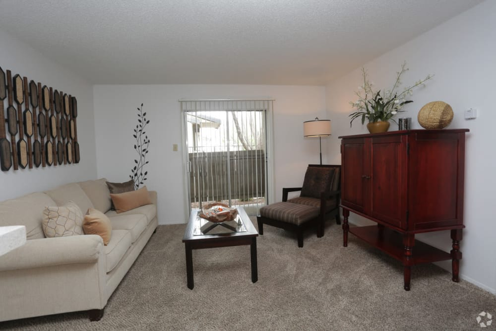 Living room with large window at Double Tree Apartments in El Paso, Texas