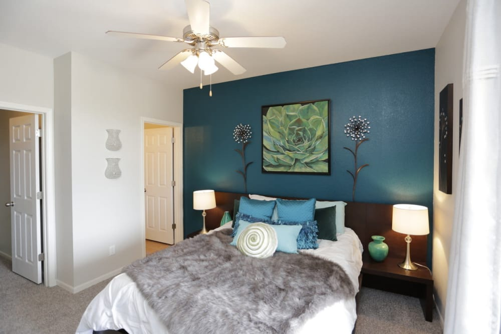 Spacious main bedroom with a large window for natural lighting at Alvadora Apartments in Lawrence, Kansas