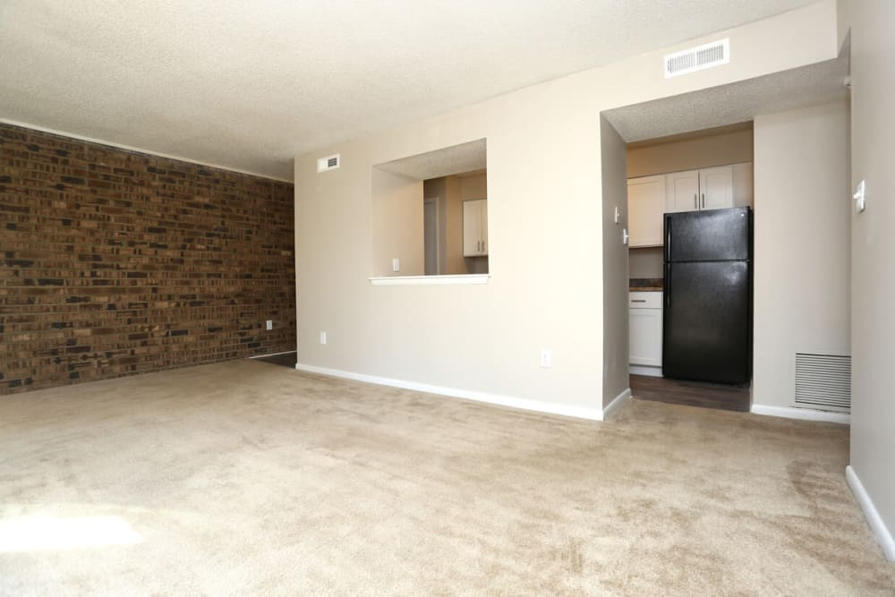 Spacious living area and kitchen entrance at Laurel Pines Apartments in Richmond, Virginia