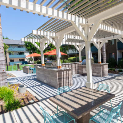 Barbecue area with pergola overhead at Haven Warner Center in Canoga Park, California