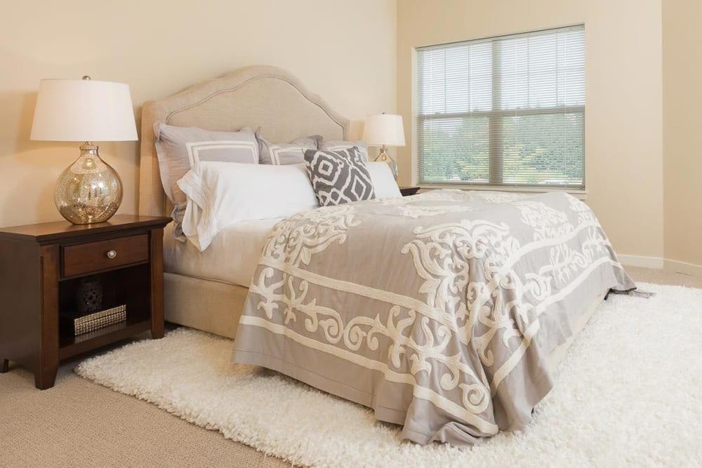 Bedroom at senior living apartment at The Springs at Tanasbourne in Hillsboro, Oregon.