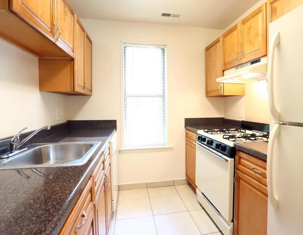 Modern kitchen with a stainless-steel sink at Laurel Hill Apartments in Lindenwold, New Jersey