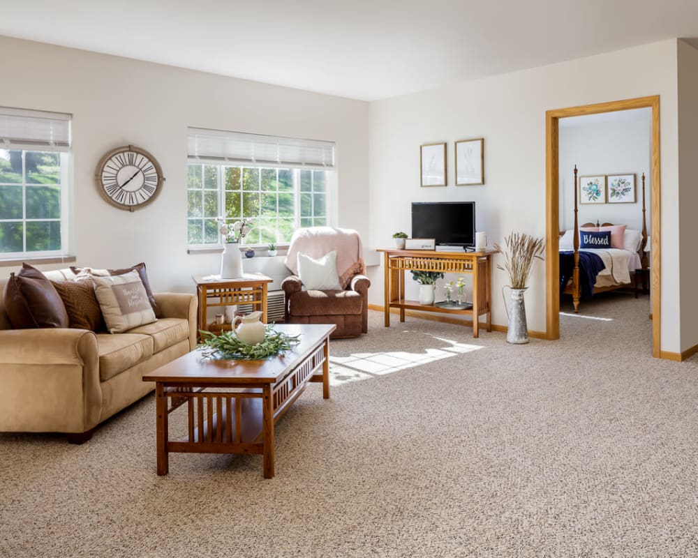 Spacious living room with large windows at Glenwood Place in Marshalltown, Iowa.