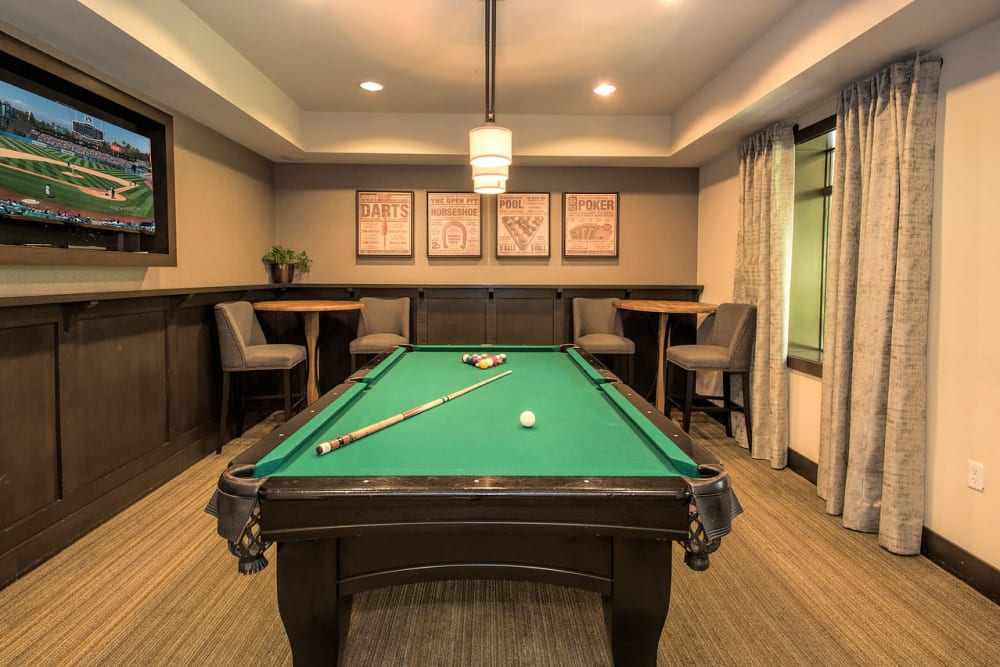 Clubhouse with a pool table at Paragon at Old Town in Monrovia, California
