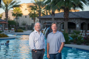 Company founders posing for a photo at one of Mark-Taylor's luxury communities