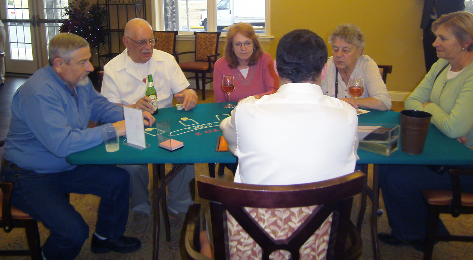 Seniors playing poker at Heritage Green Assisted Living and Memory Care in Lynchburg, Virginia