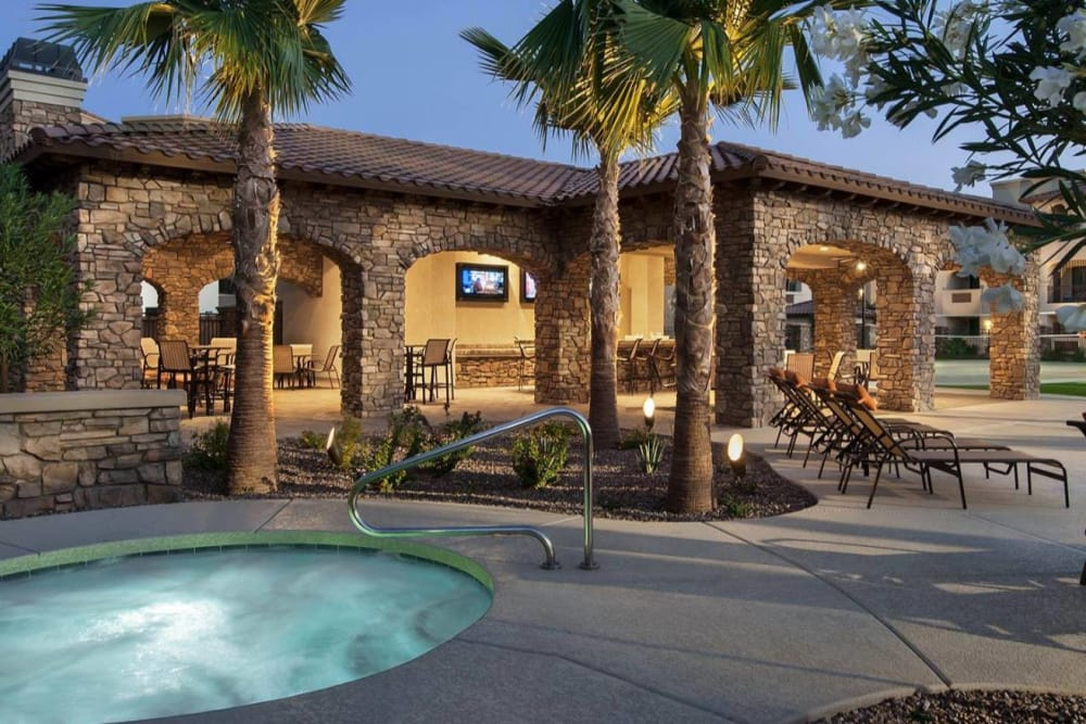 Comfortable seating by the hot tub at San Valencia in Chandler, Arizona