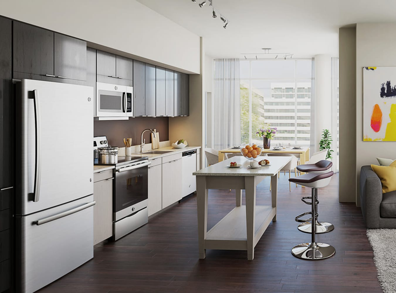 A kitchen with GE stainless-steel appliances at Solaire 8250 Georgia in Silver Spring, Maryland