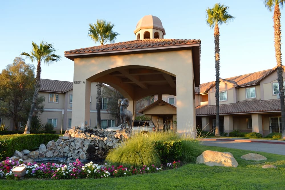 Main entrance with flowers at The Lakes at Banning in Banning, California.