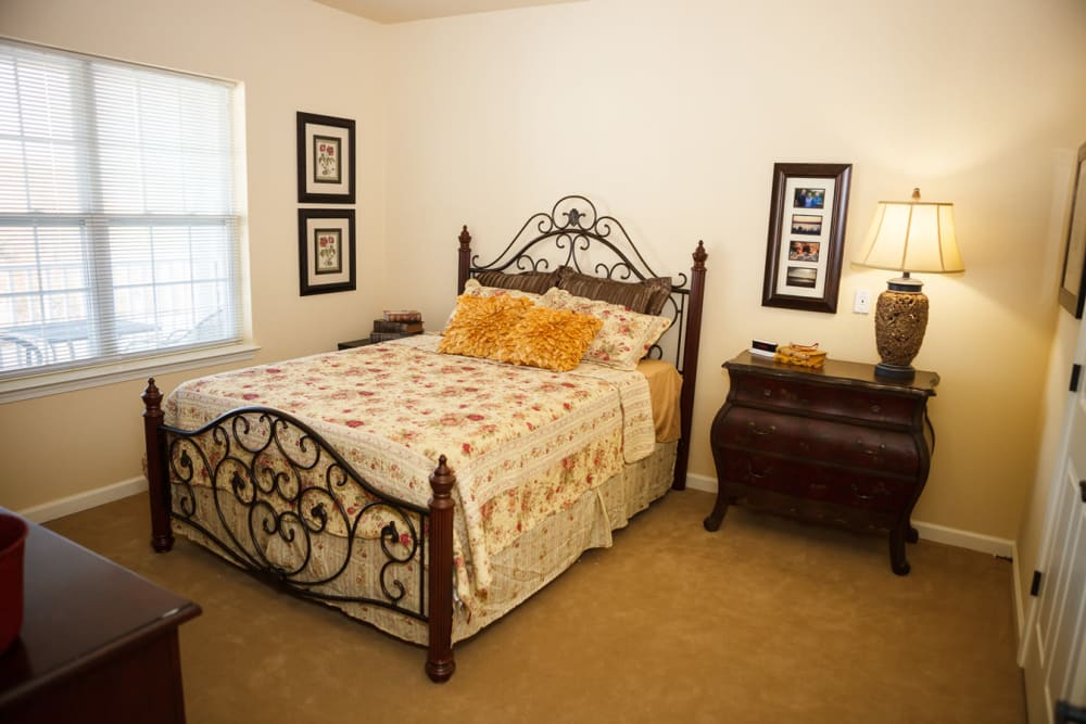 An apartment bedroom at Harmony at Falls Run in Fredericksburg, Virginia