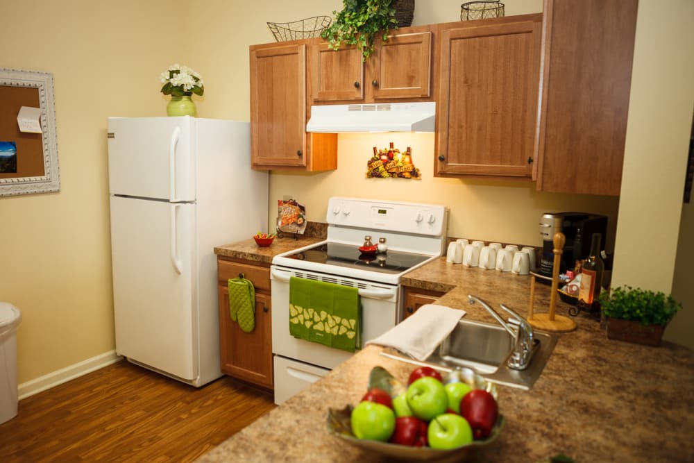 An apartment kitchen at Harmony at Falls Run in Fredericksburg, Virginia