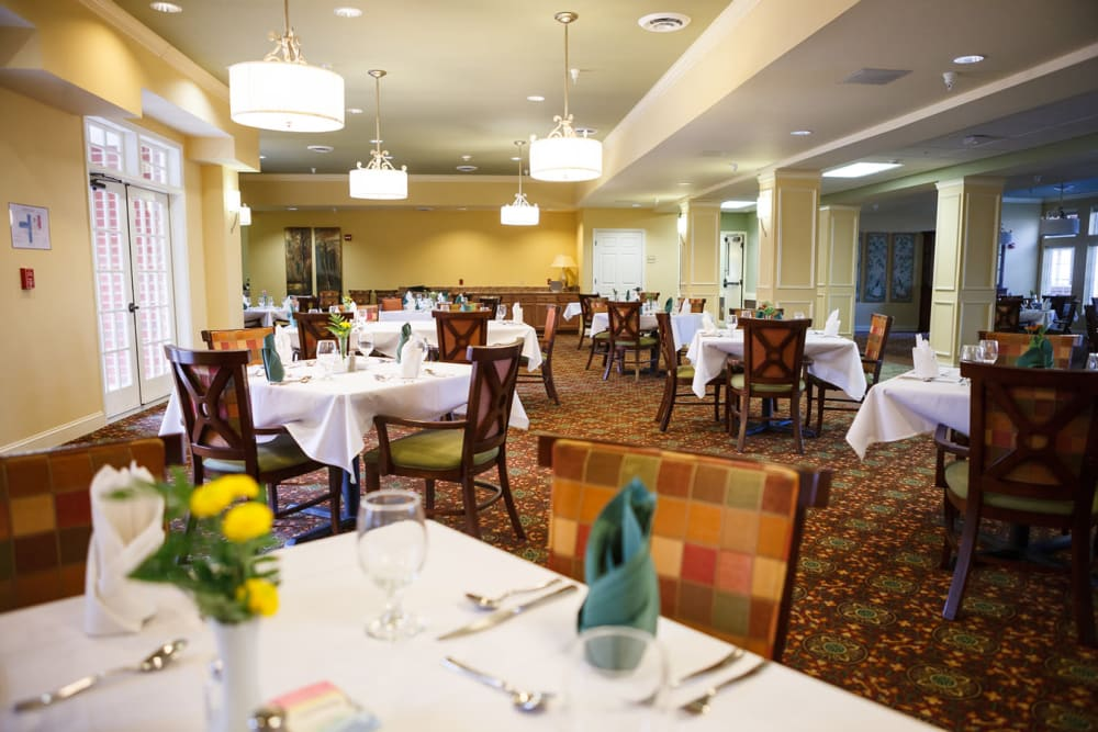 Well decorated dining room tables at Harmony at Falls Run in Fredericksburg, Virginia