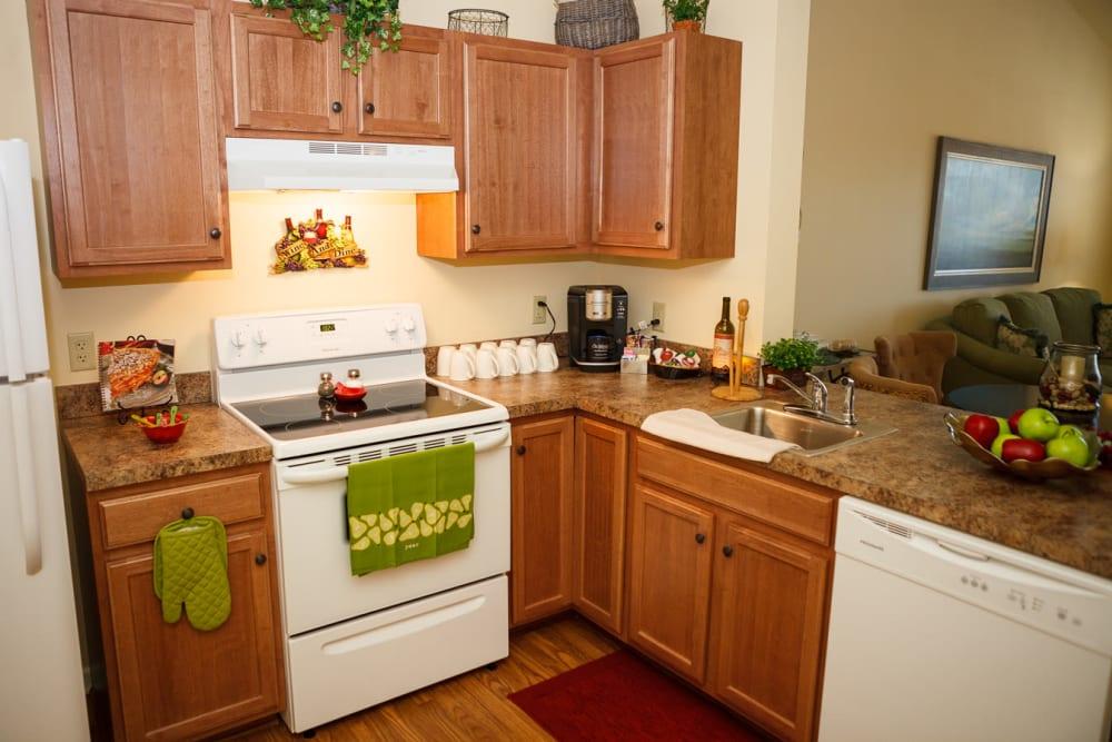 A decorated apartment kitchen at Harmony at Falls Run in Fredericksburg, Virginia